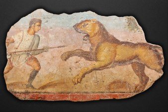 Fresco image of a man with a spear fighting a lion (from Wikimedia Commons)